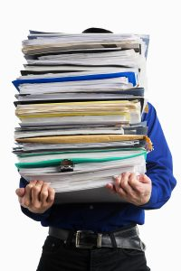Carry Pile Of Paperworks